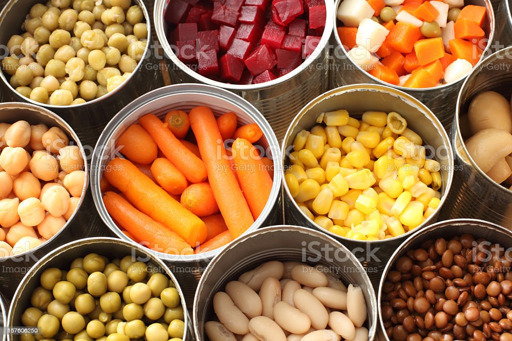 High angle view of cans filled with vegetables stock photo