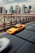 High angle view of car and yellow taxi on Brooklyn Bridge