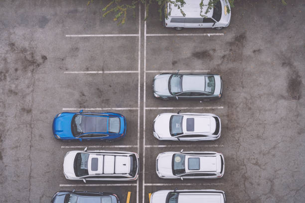 high angle view of cars parked at parking lot photo taken in canada,vancouver. parking lot stock pictures, royalty-free photos & images