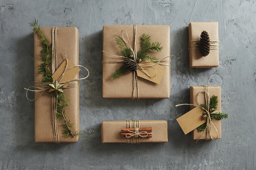 High angle view of Christmas presents wrapped in kraft paper