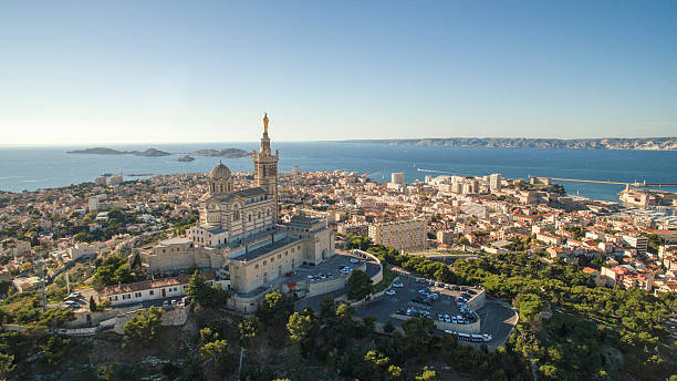 high angle view of cityscape by sea against sky - marseille photos et images de collection