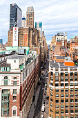 New York City, USA - April 7, 2018: Aerial view of urban cityscape construction and rooftop building windows skyscrapers in NYC Herald Square Midtown with Macy's store