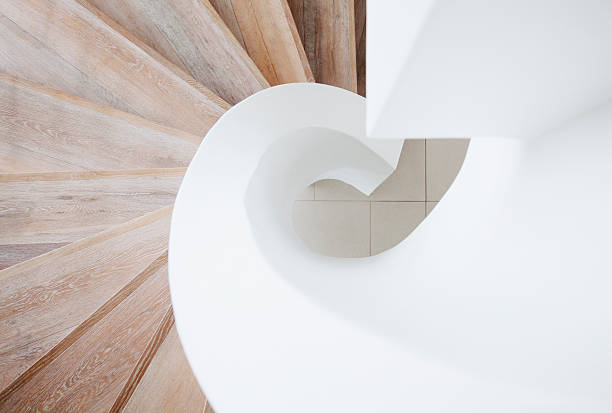 high angle view of curving staircase - architecture stock photos and pictures