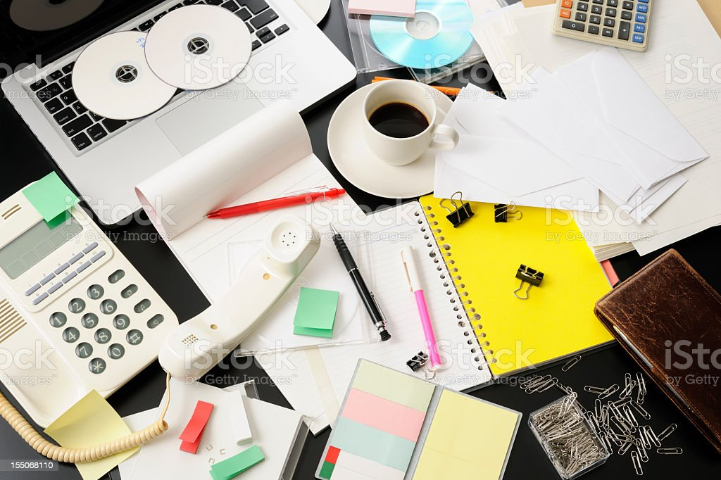 High angle view of desktop in a mess intensely royalty-free stock photo