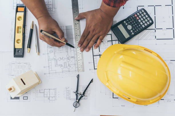 High Angle View Of Engineer Asian Person Drawing Architect Plan On Table Overweight. stock photo