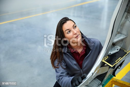 941796726istockphoto High angle view of engineer touching car chassis 916875332