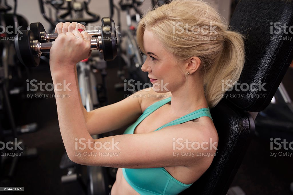 High angle view of exercising woman stock photo