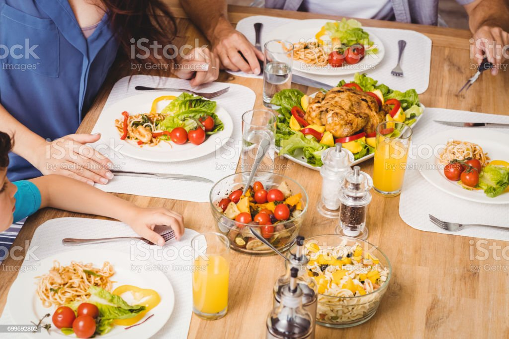 High Angle View Of Family With Food On Dining Table Stock