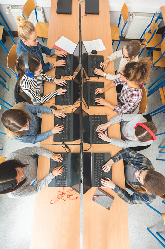 High Angle View Of Female Students Coding Stock Photo - Download Image Now