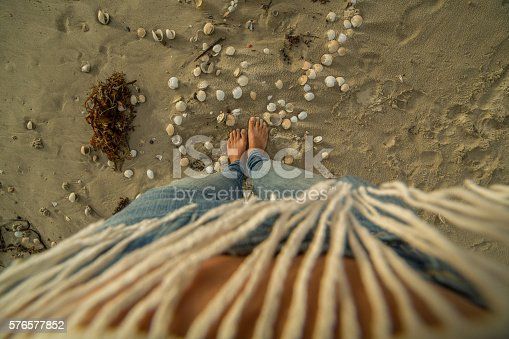 910785546 istock photo High angle view of female walking on beach 576577852