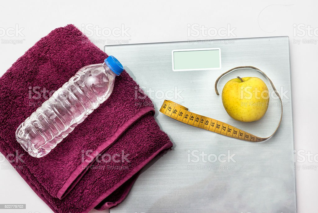 High angle view of healthy living equipments over white backgrou stock photo