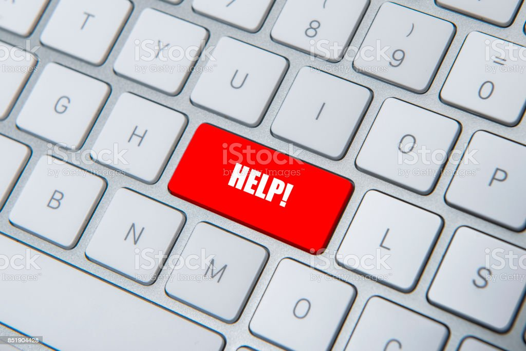 High angle view of ''HELP'' key on computer keyboard stock photo