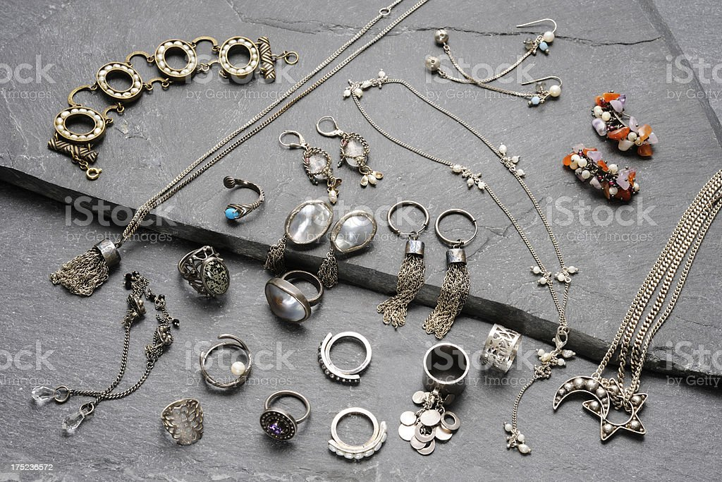 High angle view of jewelry collection on slate stock photo
