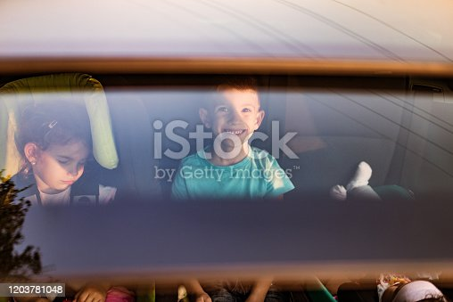 639770050 istock photo High angle view of kids traveling by car 1203781048