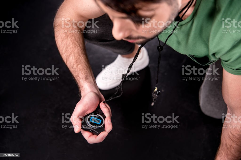 high angle view of man training with stopwatch on black royalty-free stock photo
