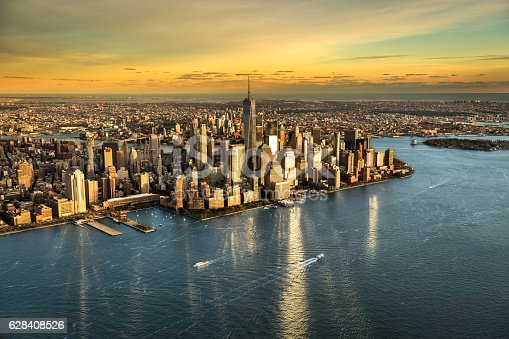 Helicopter point of view of Manhattan island in New York City at sunset.