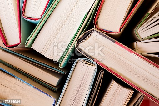 istock High angle view of many hardback books. Library or school. 475314984