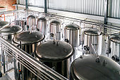 High angle view of metallic vats in brewery