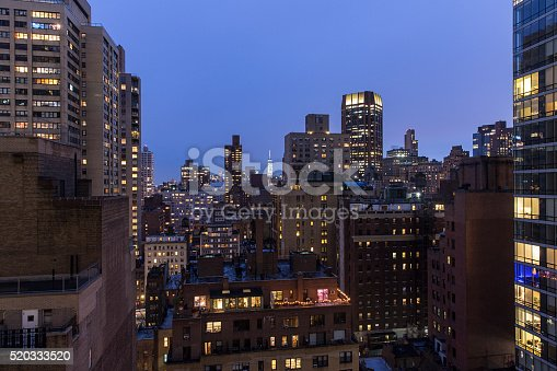 istock High angle view of New York city buildings at night 520333520
