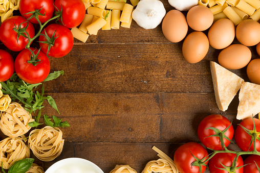High Angle View Of Pasta Ingredients On Table Stock Photo - Download Image Now