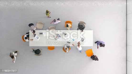 Overhead view of a group of people working in the office. All elements in the scene are 3D