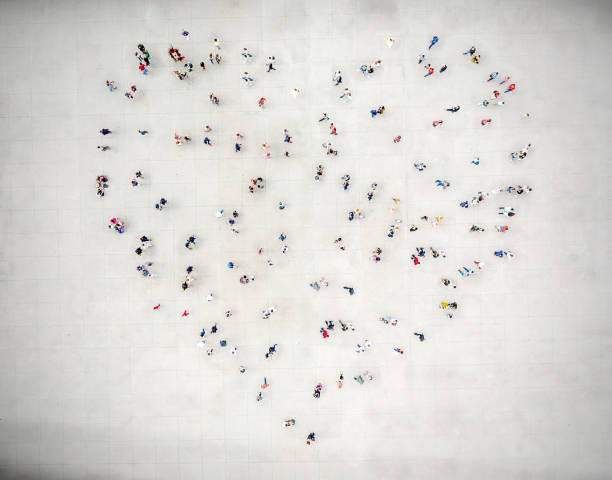 High Angle View Of People forming a heart stock photo