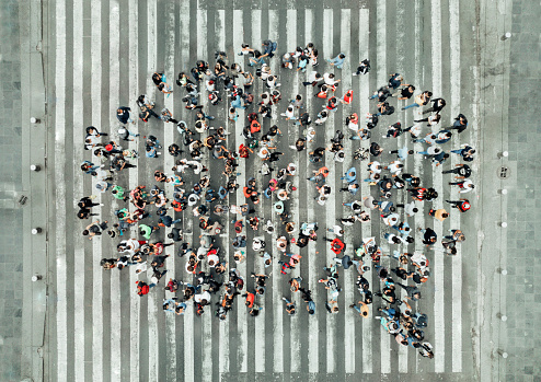 istock High Angle View Of People forming a speech bubble 1070513916