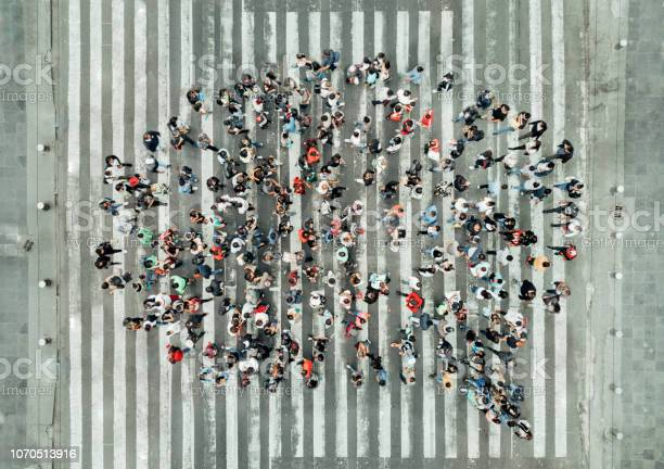 High Angle View Of People Forming A Speech Bubble Stock Photo - Download Image Now