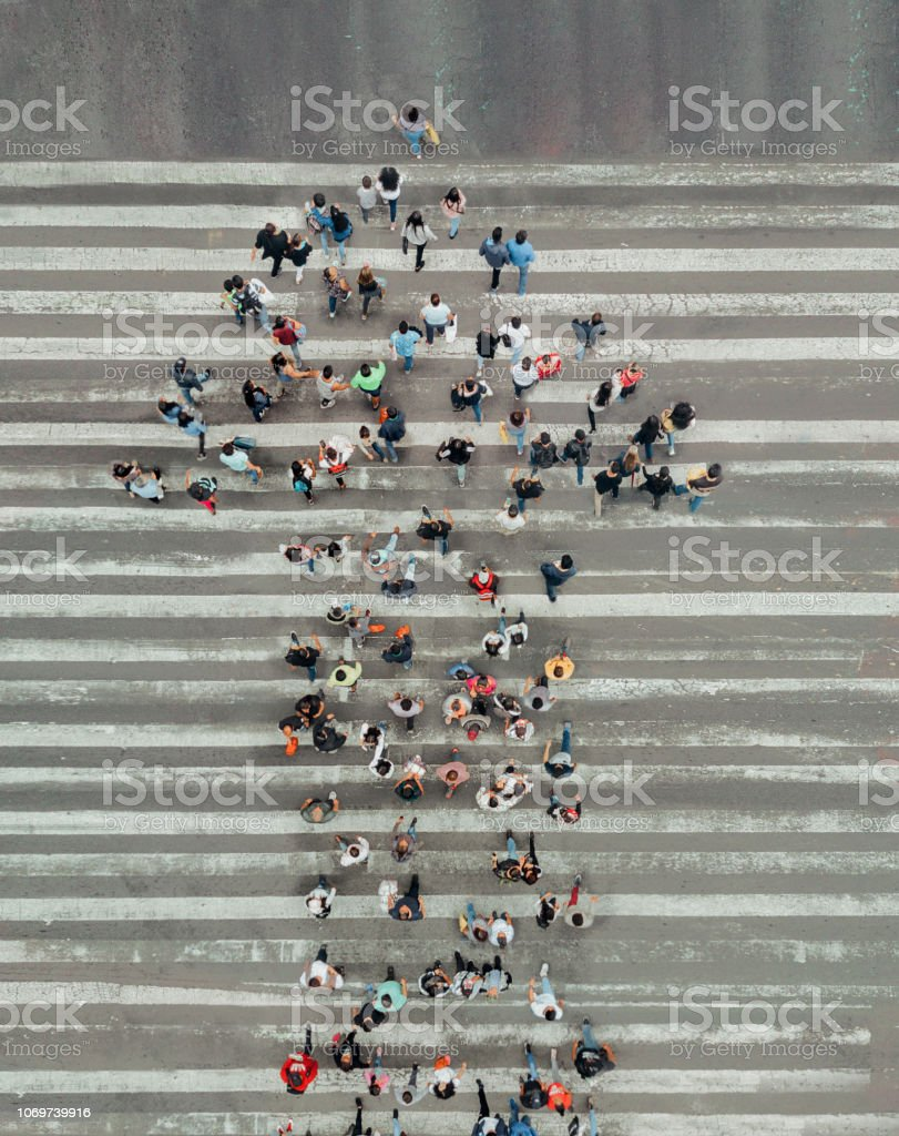 High Angle View Of People forming and arrow on the street stock photo