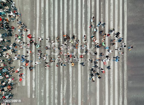 High Angle View Of People forming and arrow on the street