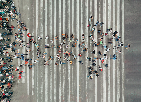 istock High Angle View Of People forming and arrow on the street 1069739918