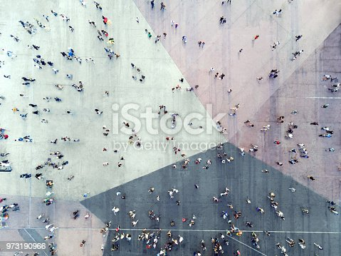 istock High Angle View Of People On Street 973190966