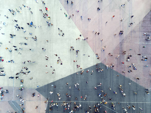 high angle view of people on street - busy stock photos and pictures