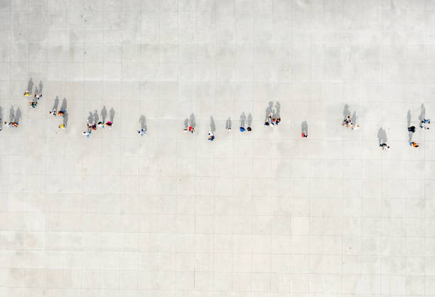 High Angle View Of People walking On Street stock photo