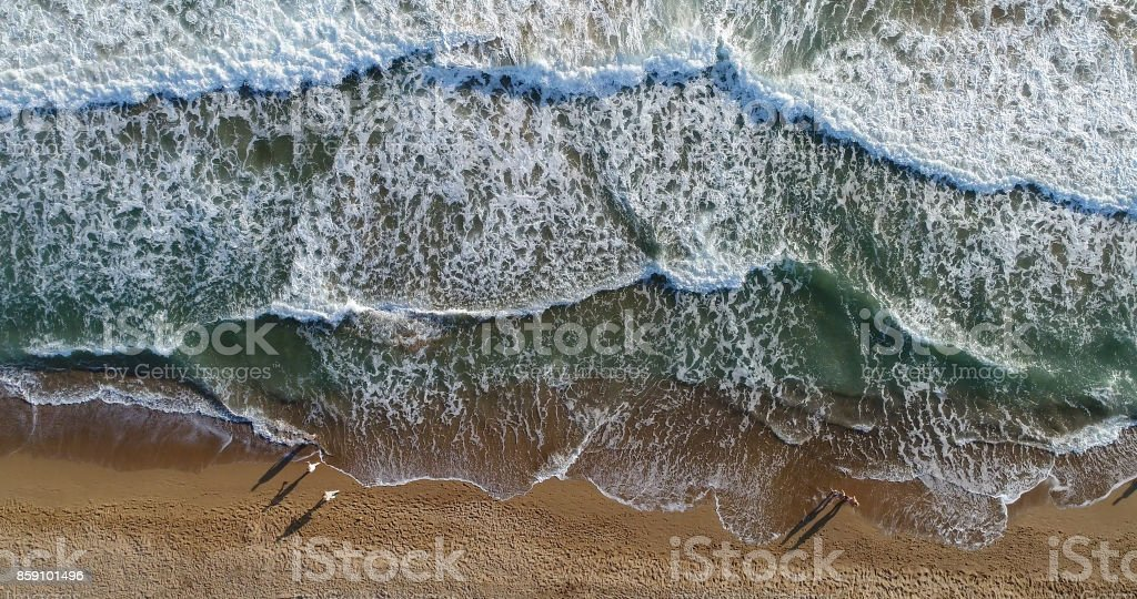 High angle view of people walking on the beach stock photo
