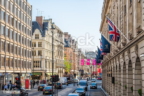 London, UK - June 22, 2018: High angle view of Piccadilly Circus Regent street with cars on street traffic road with banners hanging for the Ritz hotel