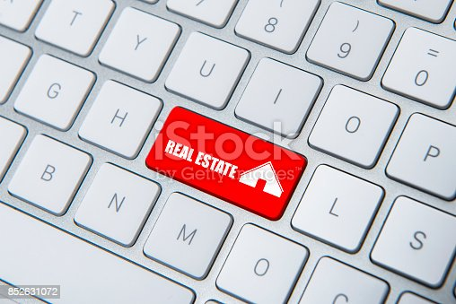 istock High angle view of ''Real Estate'' key on the computer keyboard 852631072