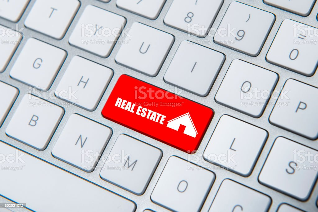 High angle view of ''Real Estate'' key on the computer keyboard stock photo