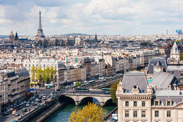 high angle view of seine river with eiffel tower in the background - paris france stock photos and pictures