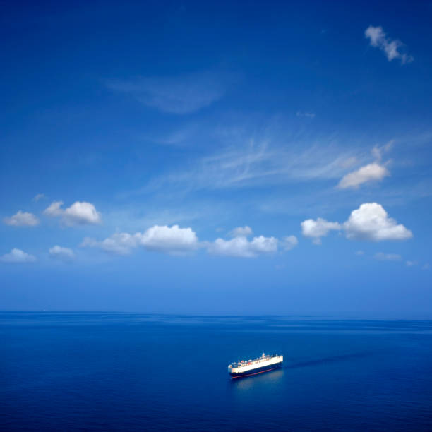 High angle view of single big cargo ship on sea over sunny blue sky stock photo