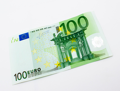 High angle view of single one hundred euro banknote over white background. Horizontal composition. Image taken in studio over isolated on white and developed from RAW format.
