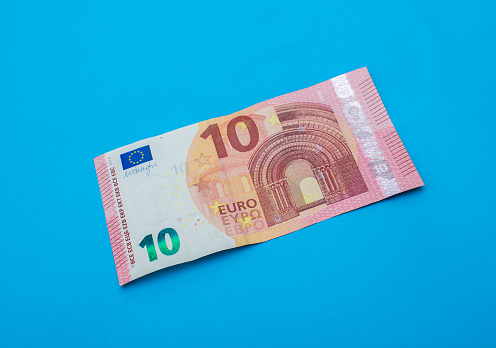 istock High angle view of single ten euro banknote 519086592