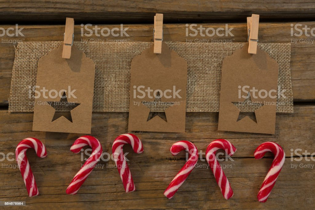 High angle view of star shape decoration with burlap and clothespin by candy canes stock photo