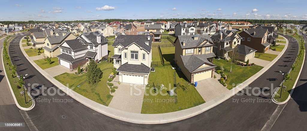 High angle view of suburban houses along a curving street stock photo