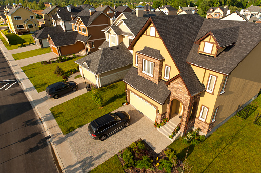 High angle view of suburban houses and cars
