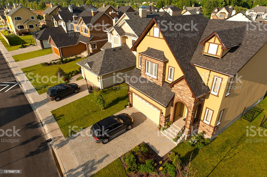 High angle view of suburban houses and cars stock photo