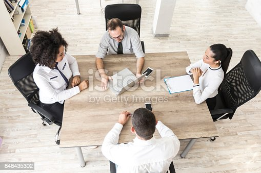 847516586 istock photo High angle view of team working in office 848435302