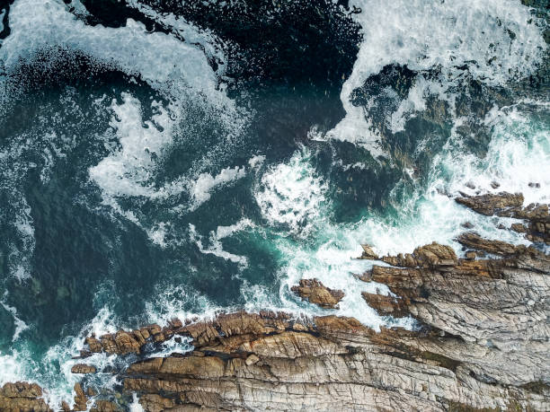 High angle view of the waves crashing against the sea stock photo
