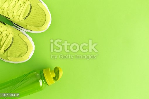 istock High angle view of trainers and bottle 967191412