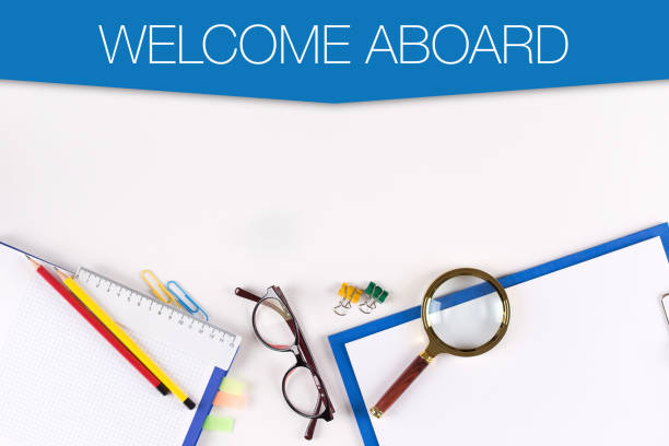 High Angle View of Various Office Supplies on Desk with a word WELCOME ABOARD High Angle View of Various Office Supplies on Desk with a word WELCOME ABOARD aboard stock pictures, royalty-free photos & images